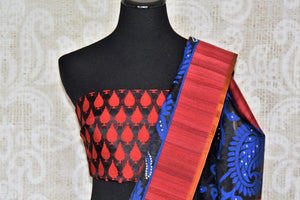 Channel contemporary vibes in this exclusively designed black kora tissue silk with banarsi weave. It comes with a red silk contrasting border and floral work. Style this sari with red and black silk blouse. Shop handloom saris, chiffon sarees, printed sari online or visit Pure Elegance store, USA.-blouse pallu