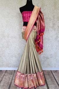 Unleash the Bollywood diva in you in this sartorial designer cream banarsi silk sari. Drape this gorgeous saree with designer fuschia and gold buta work blouse to enhance the royalty in you. Shop designer silk Indian sarees, banarasi silk sarees, georgette sarees online or visit Pure Elegance store in USA. -full view