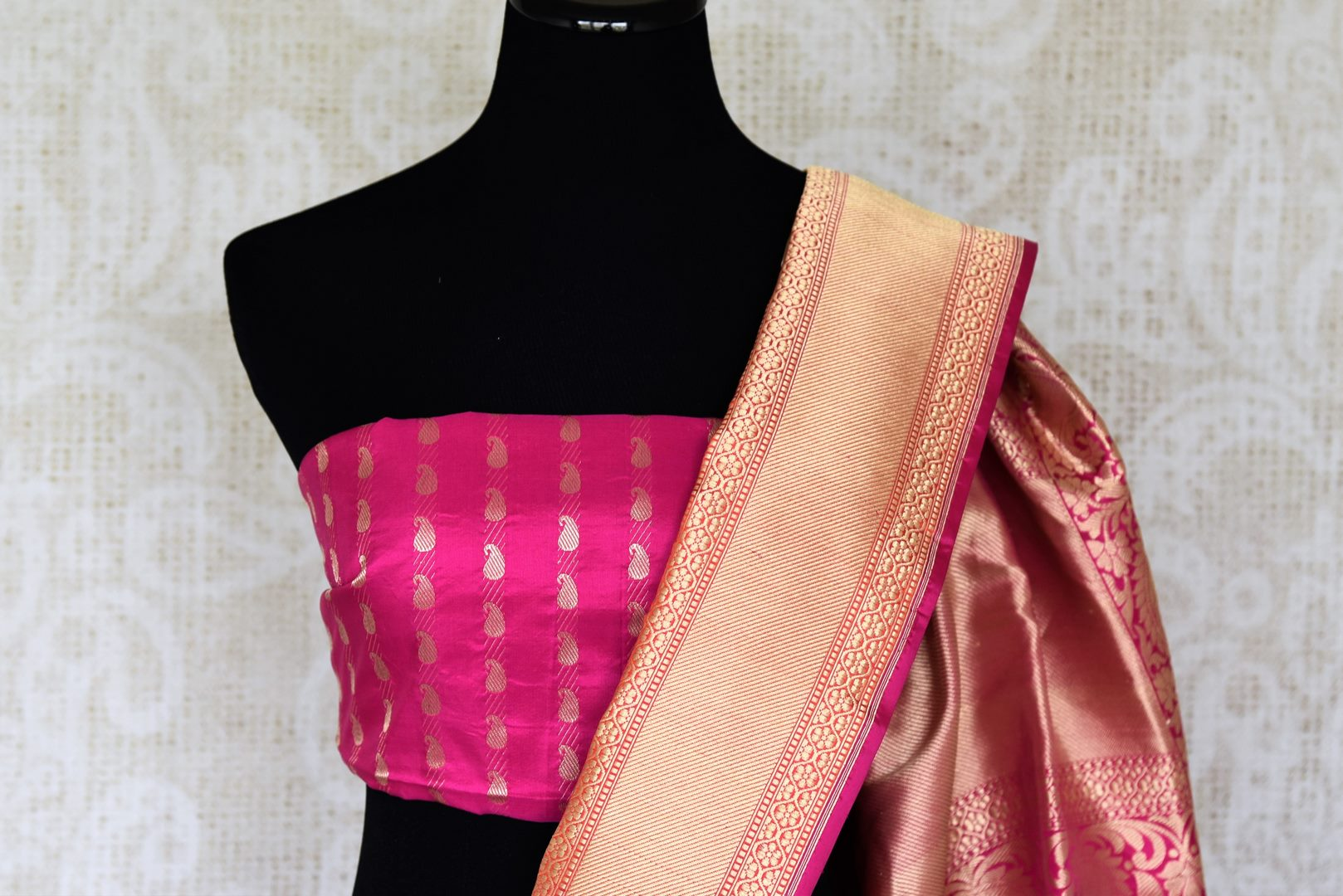 Unleash the Bollywood diva in you in this sartorial designer cream banarsi silk sari. Drape this gorgeous saree with designer fuschia and gold buta work blouse to enhance the royalty in you. Shop designer silk Indian sarees, banarasi silk sarees, georgette sarees online or visit Pure Elegance store in USA. -blouse pallu