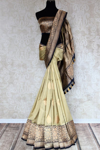 Buy online cream check Banarasi silk sari in USA with zari border. The saree is a striking drape for a traditional wedding look. If you are looking for Indian handloom sarees, Banarasi sarees in USA, then Pure Elegance is the place for you. Shop online or visit our exclusive fashion store in USA.-full view