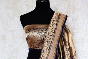 Buy online cream check Banarasi silk sari in USA with zari border. The saree is a striking drape for a traditional wedding look. If you are looking for Indian handloom sarees, Banarasi sarees in USA, then Pure Elegance is the place for you. Shop online or visit our exclusive fashion store in USA.-blouse pallu