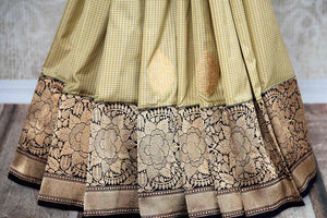 Buy online cream check Banarasi silk sari in USA with zari border. The saree is a striking drape for a traditional wedding look. If you are looking for Indian handloom sarees, Banarasi sarees in USA, then Pure Elegance is the place for you. Shop online or visit our exclusive fashion store in USA.-pleats