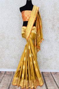 Rich gold Banarasi silk saree buy online in USA with zari buta and border. The saree is sure to bring splendor to your Indian wedding look. If you are looking for Indian designer silk sarees, Banarasi sarees in USA, then Pure Elegance clothing store is your one-stop solution, shop now.-full view