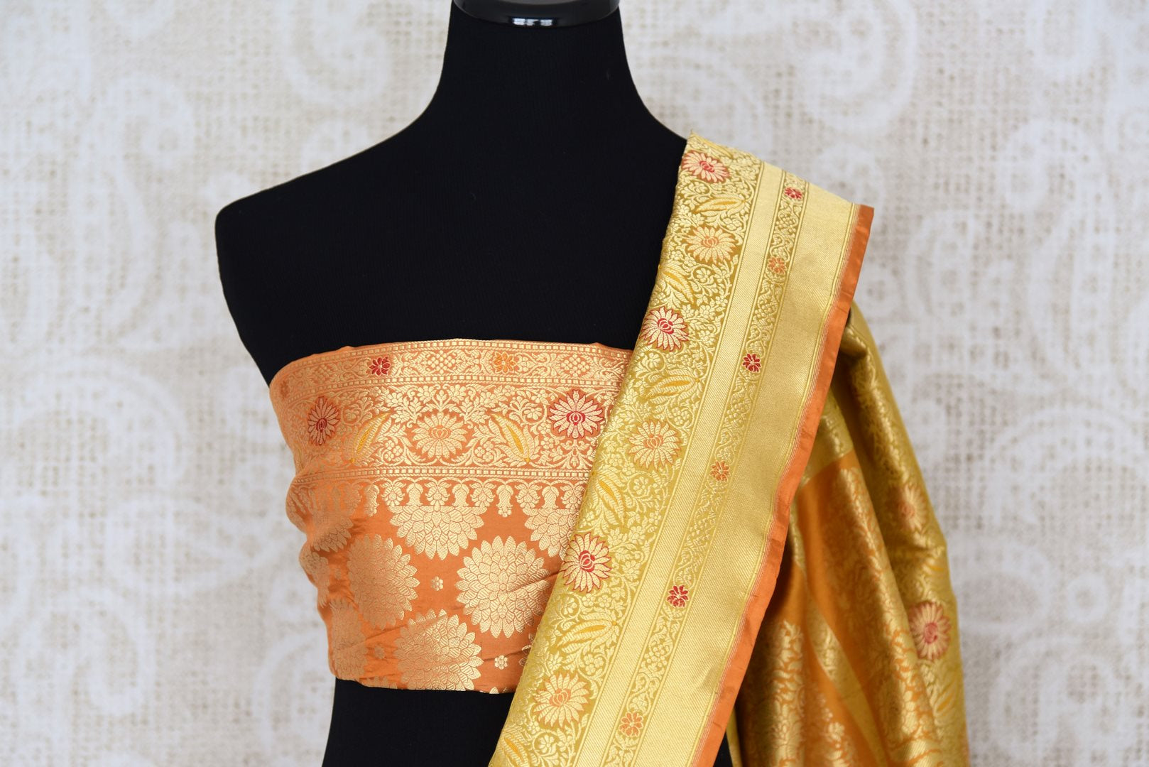Rich gold Banarasi silk saree buy online in USA with zari buta and border. The saree is sure to bring splendor to your Indian wedding look. If you are looking for Indian designer silk sarees, Banarasi sarees in USA, then Pure Elegance clothing store is your one-stop solution, shop now.-blouse pallu