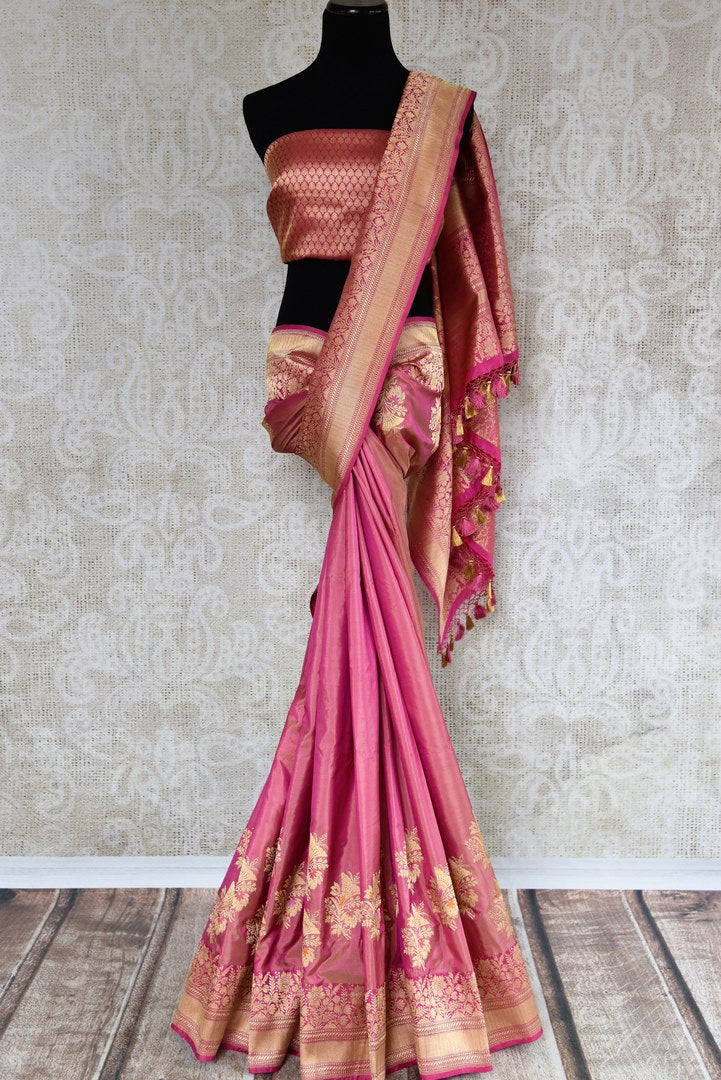 Buy online traditional pink Banarasi silk sari with floral zari buta online in USA. The saree is a stunning drape for an ethnic Indian look at weddings and special occasions. Find more such exquisite Indian silk sarees, handloom saris in USA at Pure Elegance Indian fashion store. Shop now.-full view