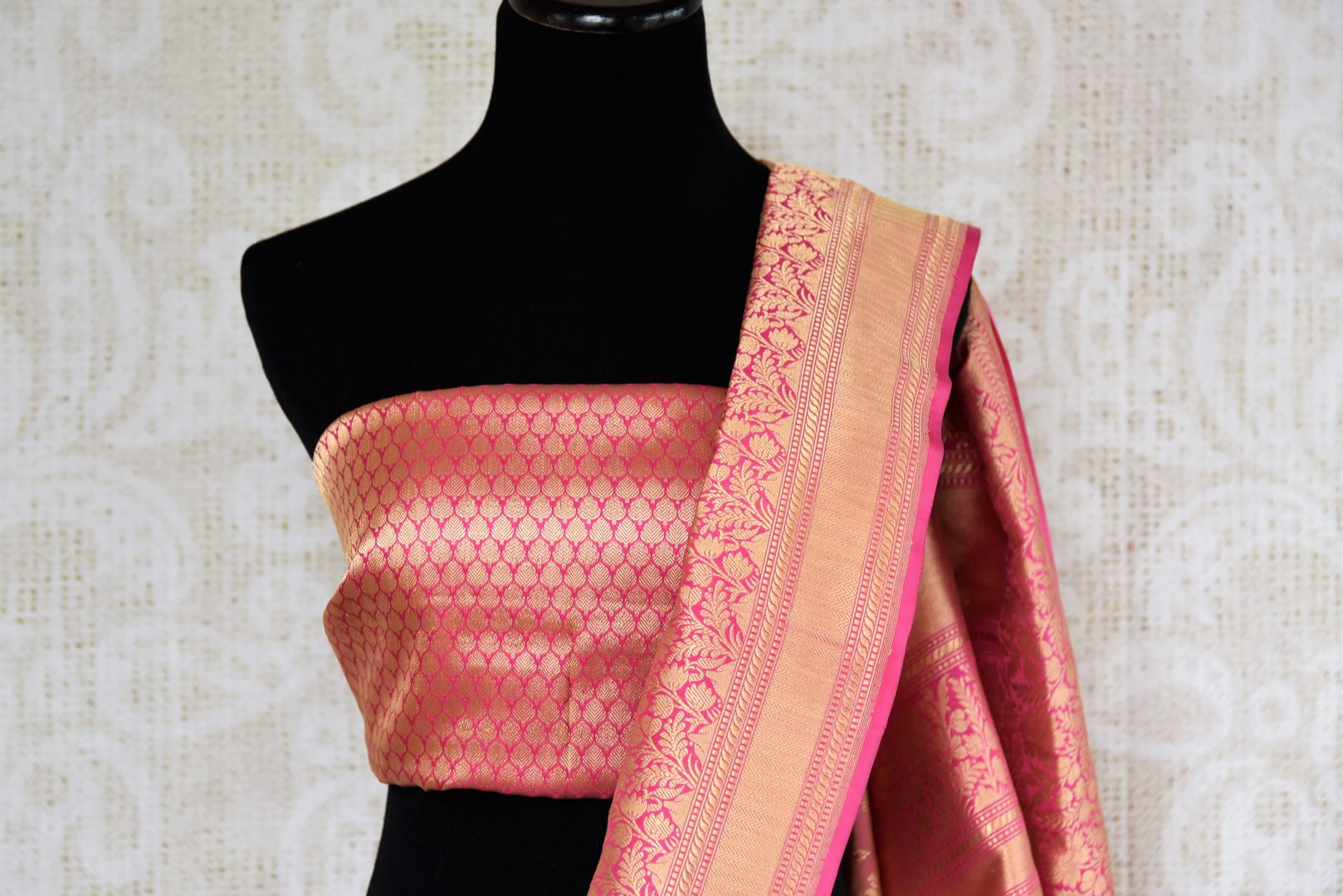 Buy online traditional pink Banarasi silk sari with floral zari buta online in USA. The saree is a stunning drape for an ethnic Indian look at weddings and special occasions. Find more such exquisite Indian silk sarees, handloom saris in USA at Pure Elegance Indian fashion store. Shop now.-blouse pallu