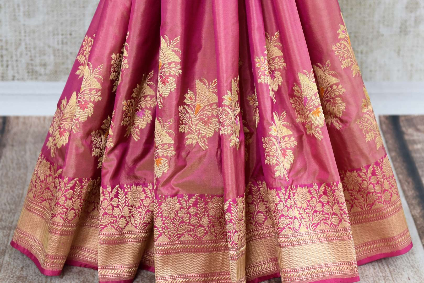Buy online traditional pink Banarasi silk sari with floral zari buta online in USA. The saree is a stunning drape for an ethnic Indian look at weddings and special occasions. Find more such exquisite Indian silk sarees, handloom saris in USA at Pure Elegance Indian fashion store. Shop now.-pleats