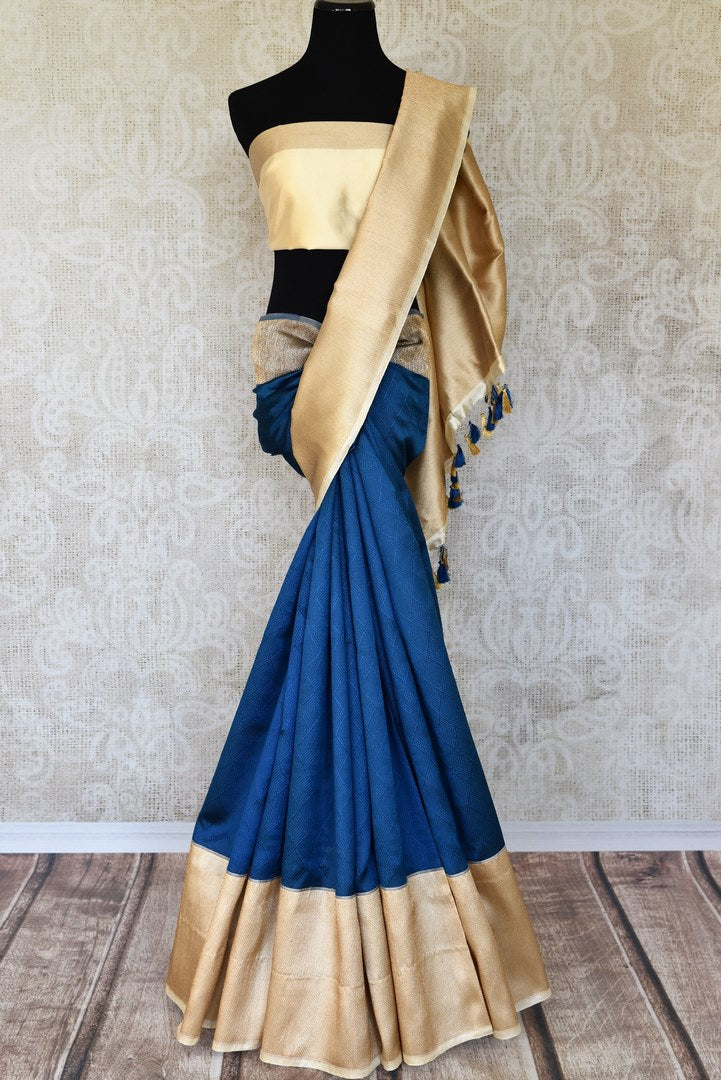 Elevate your style with suave and sophisticated royal blue banarsi silk designer saree. The gorgeous gold zari detailed border and heavily woven pallu gold zari detailed blouse makes up for a beautiful contrast. Shop handloom sarees, kanjeevaram silk saris, printed sarees online or visit Pure Elegance store, USA. -full view