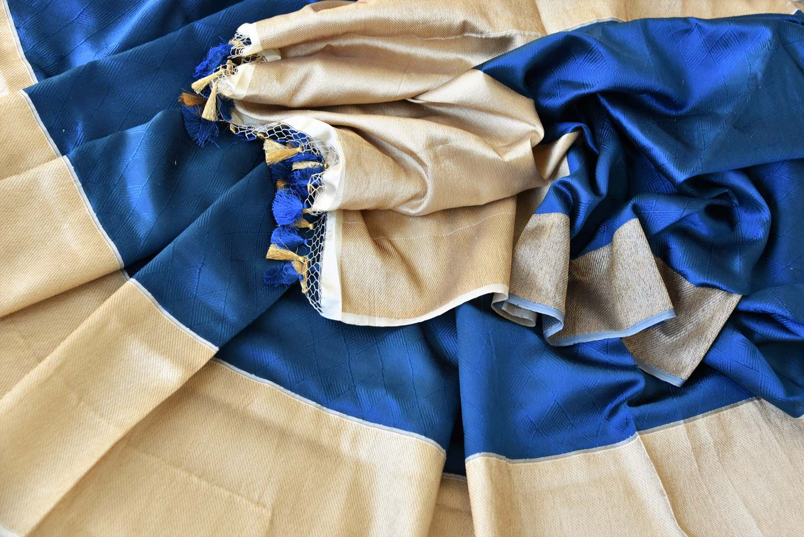 Elevate your style with suave and sophisticated royal blue banarsi silk designer saree. The gorgeous gold zari detailed border and heavily woven pallu gold zari detailed blouse makes up for a beautiful contrast. Shop handloom sarees, kanjeevaram silk saris, printed sarees online or visit Pure Elegance store, USA. -details