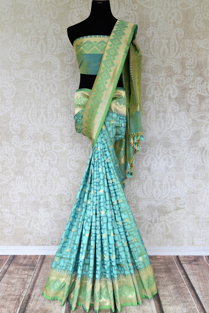 Enchant everyone as you doll up in this gorgeous sea green-hued banarsi silk sari with a rich designer pallu. Turn heads as you walk in elan and style this silk sari with a designer sea green blouse. Shop such handcrafted silk saris, ikkat sarees, printed sarees online or visit Pure Elegance store in the USA. -full view