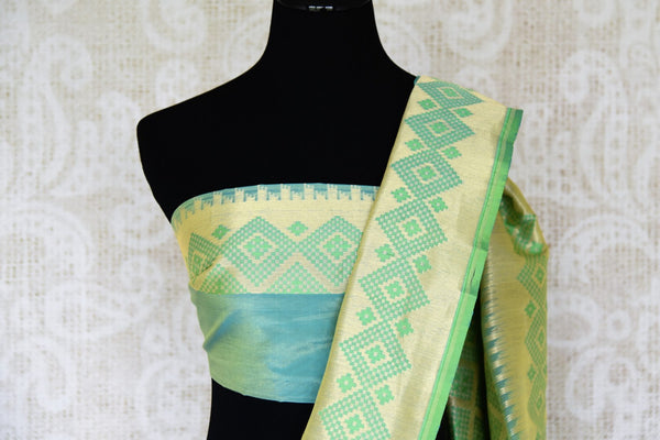 Enchant everyone as you doll up in this gorgeous sea green-hued banarsi silk sari with a rich designer pallu. Turn heads as you walk in elan and style this silk sari with a designer sea green blouse. Shop such handcrafted silk saris, ikkat sarees, printed sarees online or visit Pure Elegance store in the USA. -blouse pallu