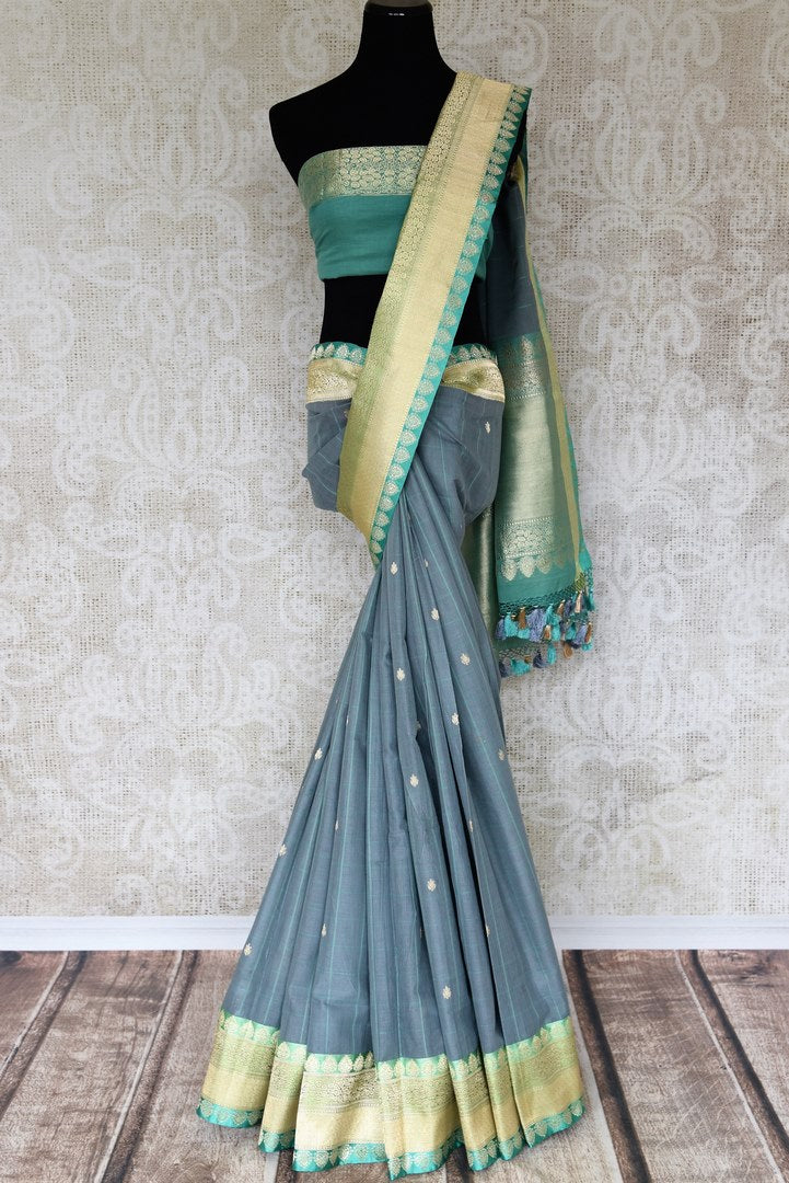Indulge in our extravagant grey linen banarsi silk saree. A classic saree for gala evenings, soirees and formal events, it features minimal buta work all over the sari. Style this stunning piece with a designer mint blouse. Shop handcrafted silk sarees, linen sari printed sari online or visit Pure Elegance store, USA.-full view