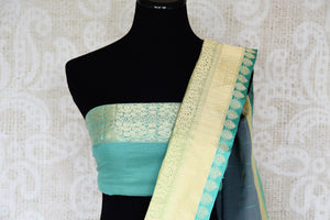 Indulge in our extravagant grey linen banarsi silk saree. A classic saree for gala evenings, soirees and formal events, it features minimal buta work all over the sari. Style this stunning piece with a designer mint blouse. Shop handcrafted silk sarees, linen sari printed sari online or visit Pure Elegance store, USA.-blouse pallu