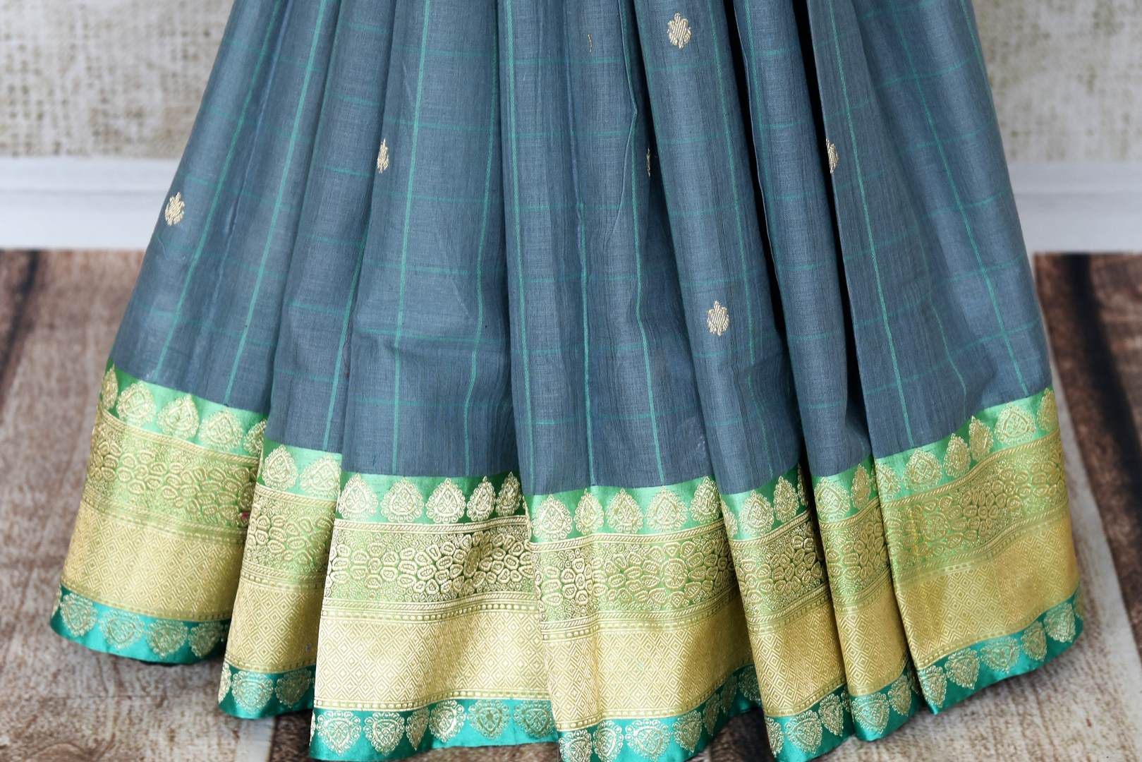 Indulge in our extravagant grey linen banarsi silk saree. A classic saree for gala evenings, soirees and formal events, it features minimal buta work all over the sari. Style this stunning piece with a designer mint blouse. Shop handcrafted silk sarees, linen sari printed sari online or visit Pure Elegance store, USA.-pleats