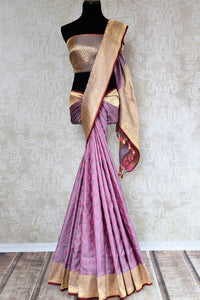 Buy online purple Banarasi silk saree in USA with zari border. The saree is a striking drape for a traditional wedding look. If you are looking for Indian handloom sarees, Banarasi silk sarees in USA, then Pure Elegance is the place for you. Shop online or visit our exclusive fashion store in USA.-full view
