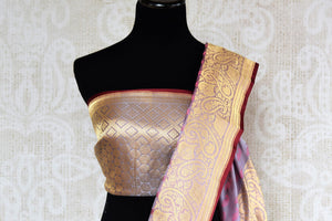 Buy online purple Banarasi silk saree in USA with zari border. The saree is a striking drape for a traditional wedding look. If you are looking for Indian handloom sarees, Banarasi silk sarees in USA, then Pure Elegance is the place for you. Shop online or visit our exclusive fashion store in USA.-blouse pallu