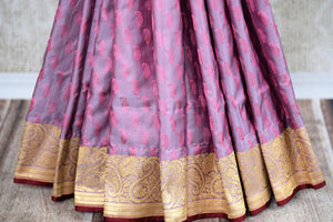 Buy online purple Banarasi silk saree in USA with zari border. The saree is a striking drape for a traditional wedding look. If you are looking for Indian handloom sarees, Banarasi silk sarees in USA, then Pure Elegance is the place for you. Shop online or visit our exclusive fashion store in USA.-pleats