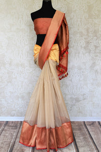 Sashay in our flamboyantly designed cream organza banarsi silk sari to special occasions. Style it with a red contrasting designer blouse. The feather as light silk sari is perfect for summers and let you breathe comfortably. Shop handloom saris, silk sarees, ikkat sari online or visit Pure Elegance store, USA. -full view