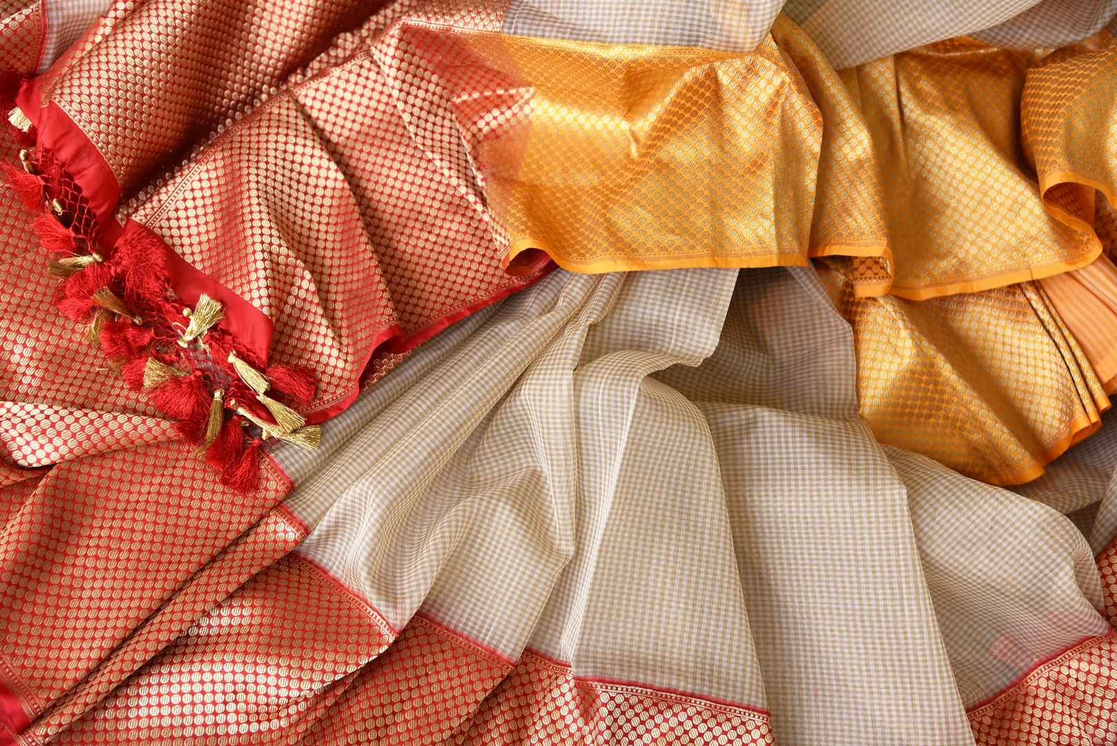 Sashay in our flamboyantly designed cream organza banarsi silk sari to special occasions. Style it with a red contrasting designer blouse. The feather as light silk sari is perfect for summers and let you breathe comfortably. Shop handloom saris, silk sarees, ikkat sari online or visit Pure Elegance store, USA. -details