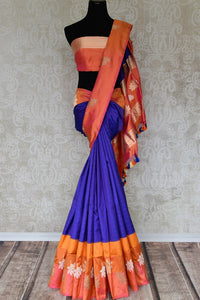 Flawlessly designed blue banarsi silk saree with a stunning combination of orange buta work border, it is perfect for parties, weddings and formal events. Style this sari with a rich silk orange blouse to ooze the sass. Shop handcrafted silk sarees, designer sari, printed saris online or visit Pure Elegance store, USA.-full view