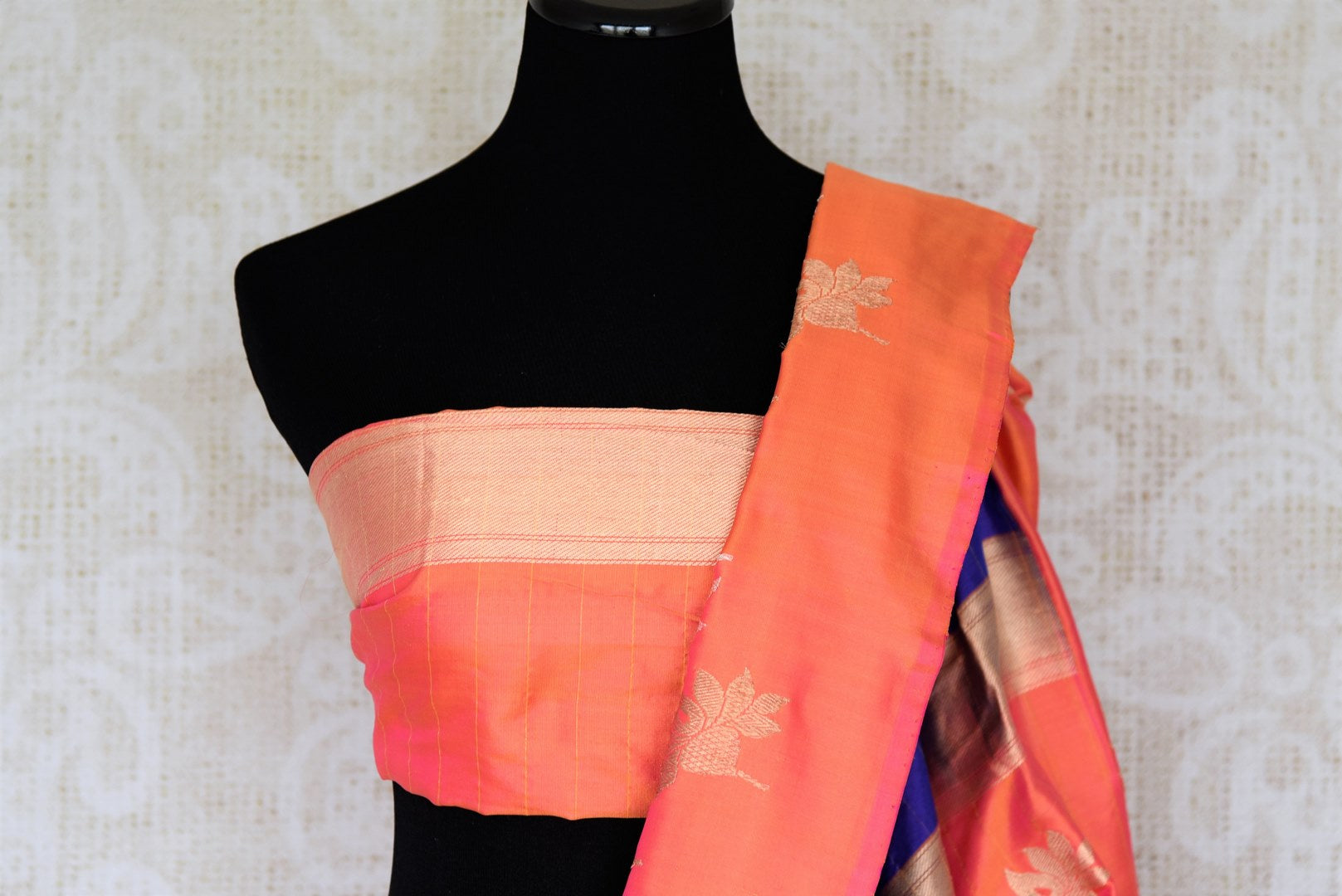 Flawlessly designed blue banarsi silk saree with a stunning combination of orange buta work border, it is perfect for parties, weddings and formal events. Style this sari with a rich silk orange blouse to ooze the sass. Shop handcrafted silk sarees, designer sari, printed saris online or visit Pure Elegance store, USA.-bloue pallu