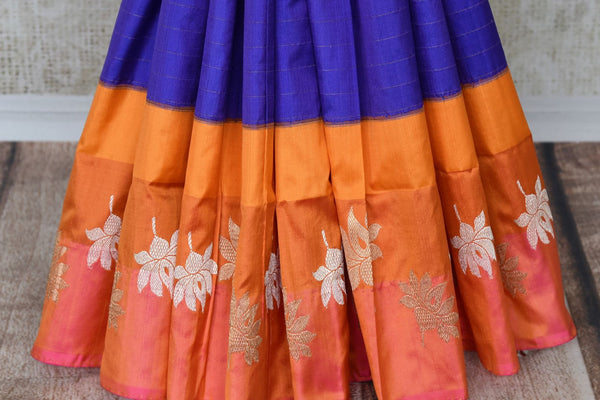Flawlessly designed blue banarsi silk saree with a stunning combination of orange buta work border, it is perfect for parties, weddings and formal events. Style this sari with a rich silk orange blouse to ooze the sass. Shop handcrafted silk sarees, designer sari, printed saris online or visit Pure Elegance store, USA.-pleats