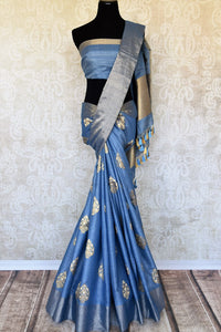 Escalate your style game in this stunning blue linen silk saree with intricate buta work. The dull gold buta work all over the saree with a heavily woven pallu is a perfect ensemble when styled with blue and gold silk blouse. Shop handloom saris, silk saree, printed saree online or visit Pure Elegance store, USA.-full view