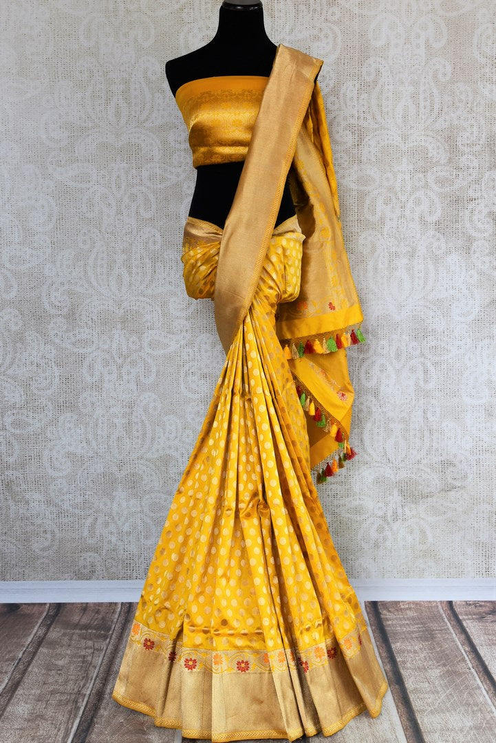 Buy bright yellow Banarasi silk saree with zari border online in USA. The saree is a perfect drape for a rich traditional Indian look at weddings and special occasions. Spoil yourself with an exquisite collection of Indian Banarasi saris, silk sarees in USA available at Pure Elegance Indian clothing store. -full view