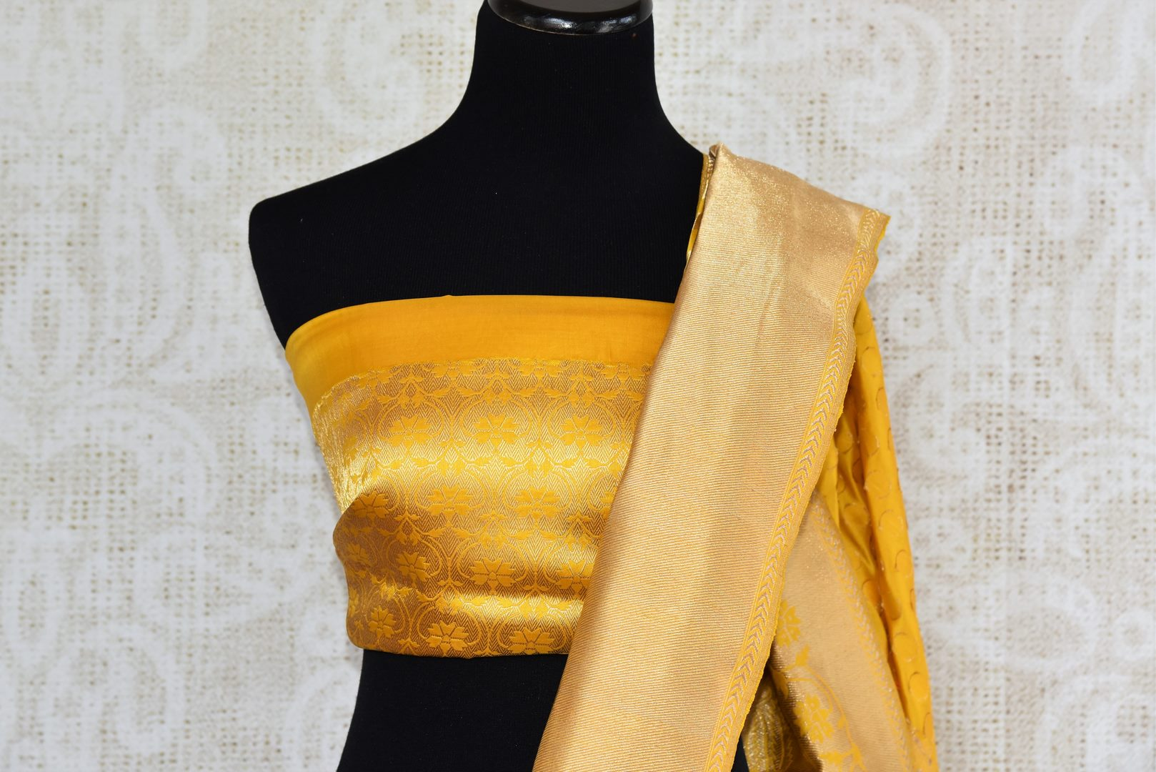 Buy bright yellow Banarasi silk saree with zari border online in USA. The saree is a perfect drape for a rich traditional Indian look at weddings and special occasions. Spoil yourself with an exquisite collection of Indian Banarasi saris, silk sarees in USA available at Pure Elegance Indian clothing store. -blouse pallu
