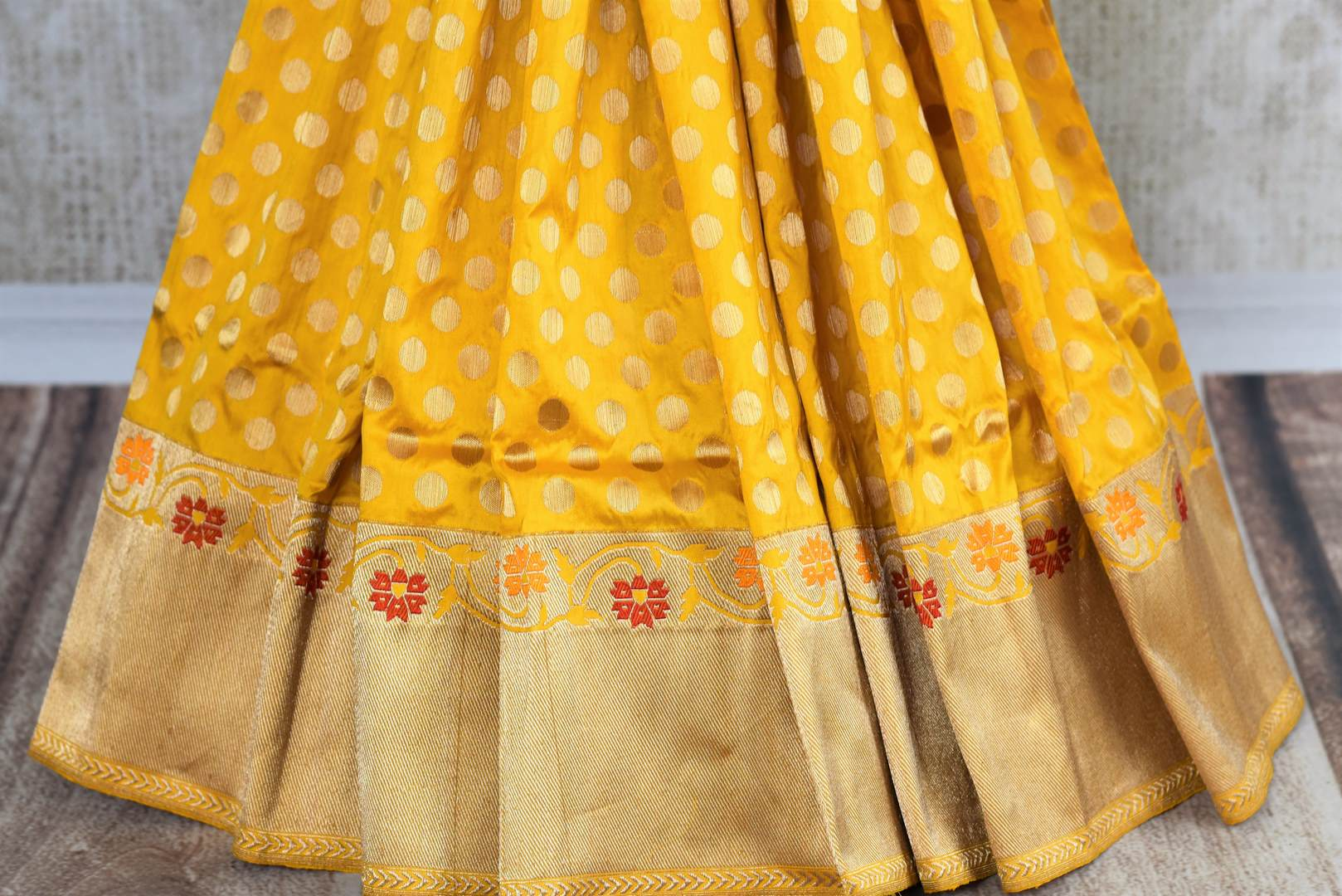 Buy bright yellow Banarasi silk saree with zari border online in USA. The saree is a perfect drape for a rich traditional Indian look at weddings and special occasions. Spoil yourself with an exquisite collection of Indian Banarasi saris, silk sarees in USA available at Pure Elegance Indian clothing store. -pleats