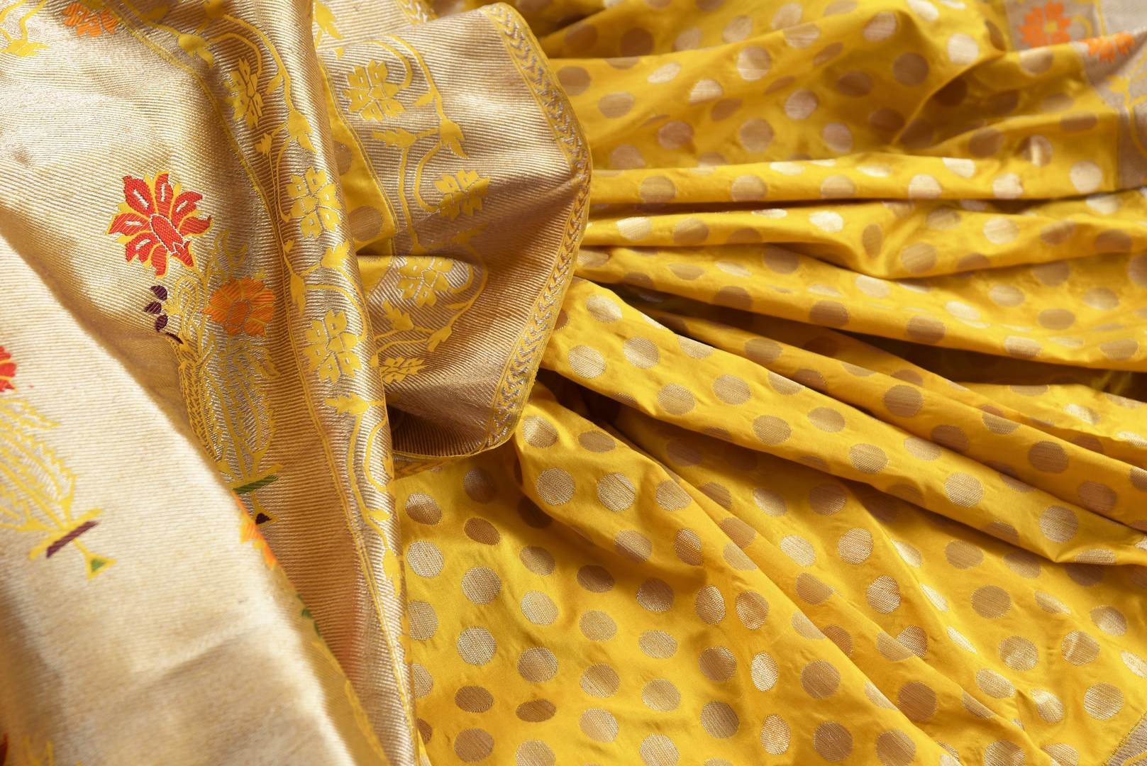 Buy bright yellow Banarasi silk saree with zari border online in USA. The saree is a perfect drape for a rich traditional Indian look at weddings and special occasions. Spoil yourself with an exquisite collection of Indian Banarasi saris, silk sarees in USA available at Pure Elegance Indian clothing store. -details