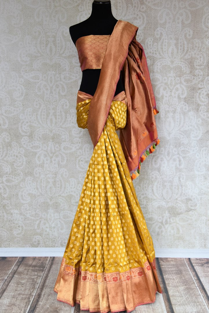 Buy online yellow Banarasi silk saree in USA with zari border. The saree is a rich drape for a traditional wedding look. If you are looking for Indian handloom sarees, Banarasi silk saris in USA, then Pure Elegance is the place for you. Shop online or visit our exclusive fashion store in USA.-full view