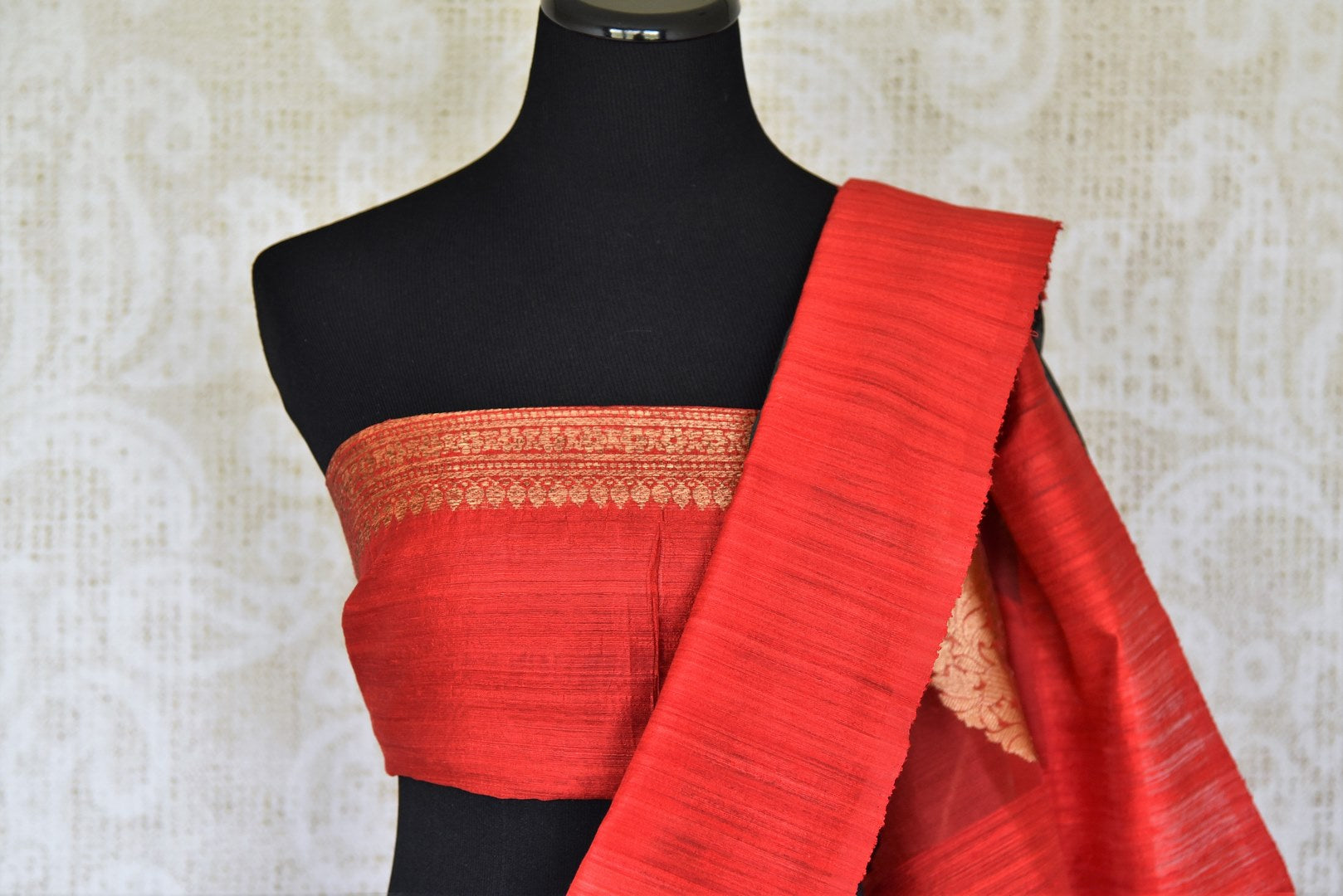 The signature combination of black and red blended in this designer kora banarsi silk saree is quite a treat for women. Strike a lasting impression with the red zari detailed blouse and heavily woven pallu. Shop handcrafted silk saris, georgette saris, ikkat sarees online or visit Pure Elegance store, USA. -blouse pallu