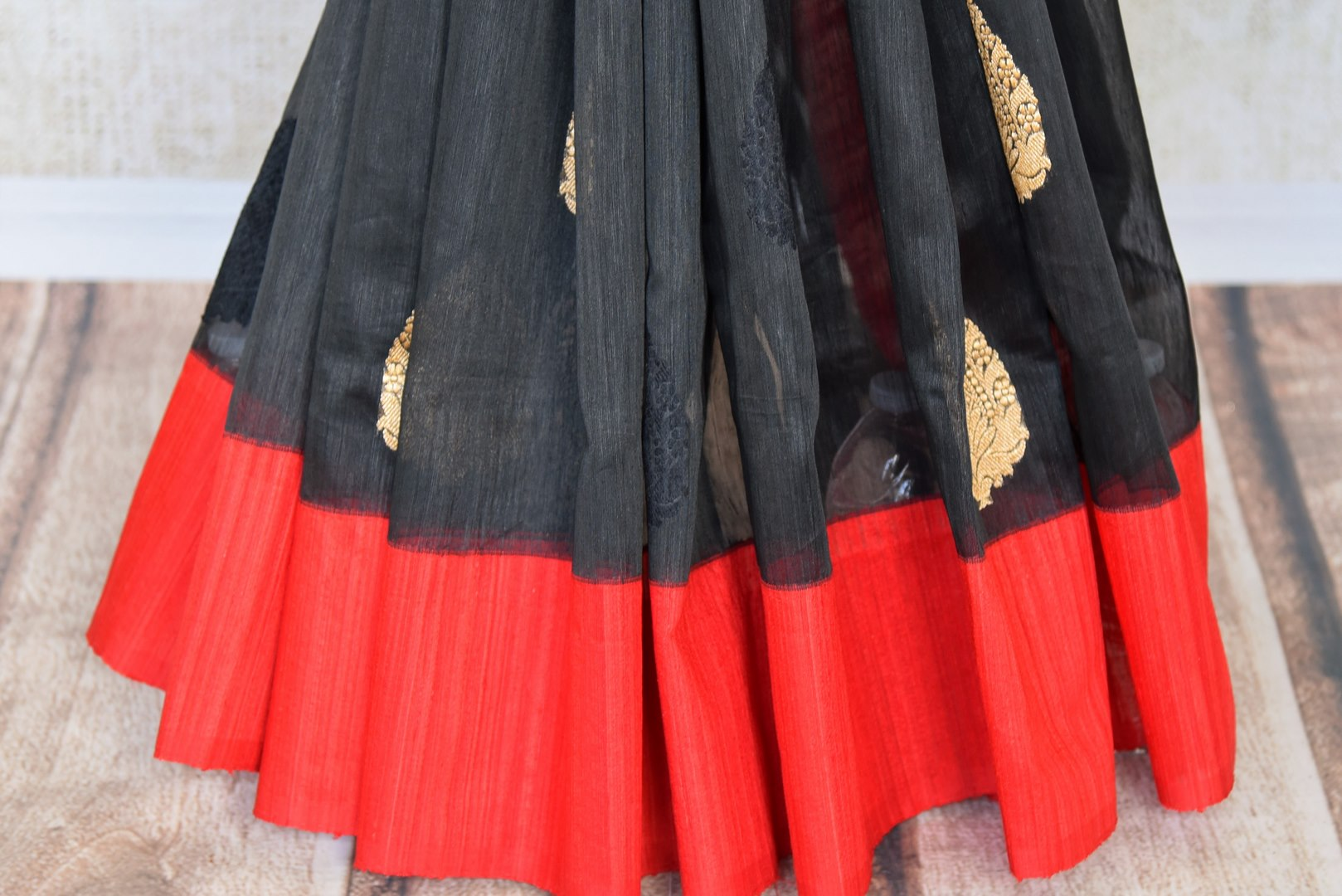 The signature combination of black and red blended in this designer kora banarsi silk saree is quite a treat for women. Strike a lasting impression with the red zari detailed blouse and heavily woven pallu. Shop handcrafted silk saris, georgette saris, ikkat sarees online or visit Pure Elegance store, USA. -pleats