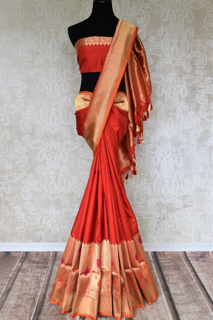 The classic saree in red and gold banarsi silk is here to woo you away. The heavily embroidered gold pallu and the border with the red and gold zari blouse reflect the old-world charm.Shop handloom sarees, silk saris, ikkat saris online or visit Pure Elegance store, USA. -full view