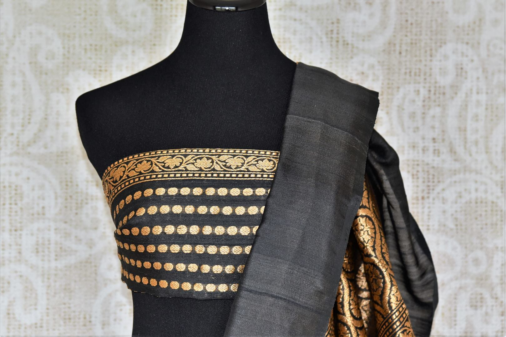 Adorn the beauty of our traditional drape with designer cream khadi banarsi silk sari. The gorgeous contrast of cream with black rich embroidered pallu and graceful designer blouse with buta work looks stunning. Shop handloom sarees, kanjeevaram silk sarees, Indian dresses online or visit Pure Elegance store, USA. -blouse pallu