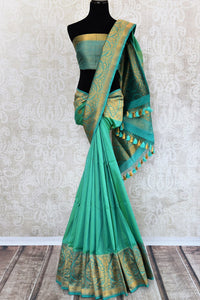Buy green tussar katan Banarasi saree with zari border online in USA. The saree is a perfect drape for a rich traditional Indian look at weddings and special occasions. Spoil yourself with an exquisite collection of Indian Banarasi saris, silk saris in USA available at Pure Elegance Indian clothing store. -full view