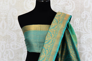Buy green tussar katan Banarasi saree with zari border online in USA. The saree is a perfect drape for a rich traditional Indian look at weddings and special occasions. Spoil yourself with an exquisite collection of Indian Banarasi saris, silk saris in USA available at Pure Elegance Indian clothing store. -blouse pallu