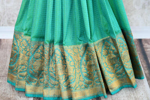 Buy green tussar katan Banarasi saree with zari border online in USA. The saree is a perfect drape for a rich traditional Indian look at weddings and special occasions. Spoil yourself with an exquisite collection of Indian Banarasi saris, silk saris in USA available at Pure Elegance Indian clothing store. -pleats