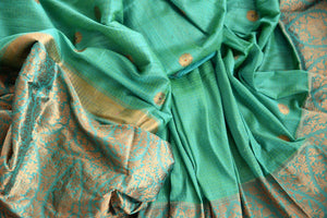 Buy green tussar katan Banarasi saree with zari border online in USA. The saree is a perfect drape for a rich traditional Indian look at weddings and special occasions. Spoil yourself with an exquisite collection of Indian Banarasi saris, silk saris in USA available at Pure Elegance Indian clothing store. -details