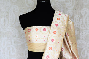 An epitome of grace and poise, this white banarsi silk sari featuring a beautiful floral embroidery is magnificent. It comes with a royal designer blouse and a heavily embroidered pallu. Shop such handcrafted silk saris, printed sarees, kanjeevaram silk sarees, Indian dresses online or visit Pure Elegance store in USA.-blouse pallu