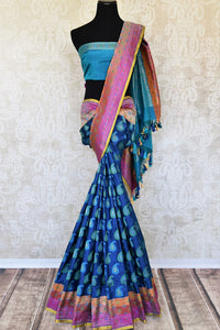 Accentuate your stylish self in this blue banarsi silk designer saree. Featuring woven design all over, the spectacular pink pallu creates a beautiful effect. Shop handloom sarees, silk saris, printed sarees online or visit Pure Elegance store, USA.-full view