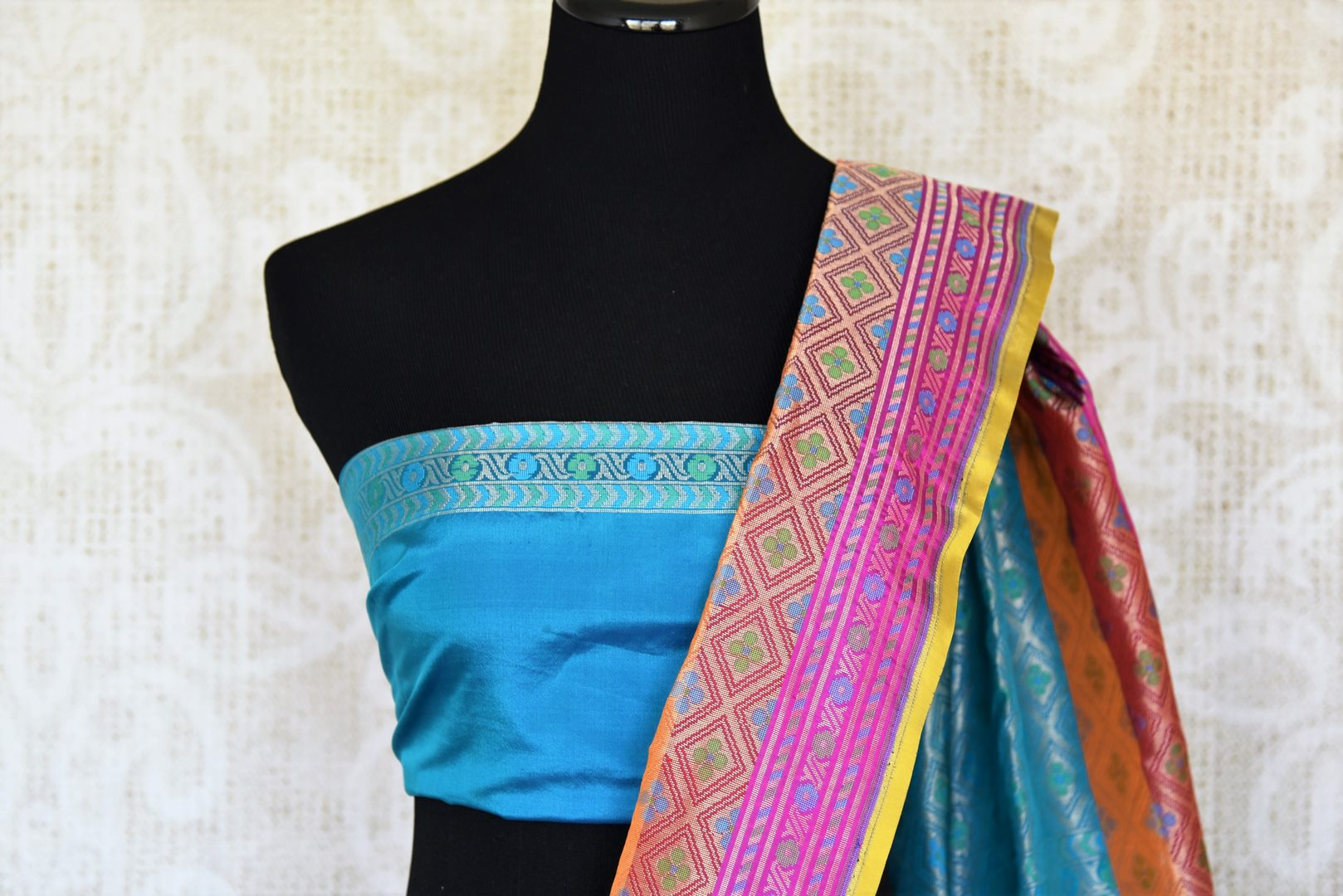 Accentuate your stylish self in this blue banarsi silk designer saree. Featuring woven design all over, the spectacular pink pallu creates a beautiful effect. Shop handloom sarees, silk saris, printed sarees online or visit Pure Elegance store, USA.-blouse pallu