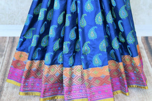 Accentuate your stylish self in this blue banarsi silk designer saree. Featuring woven design all over, the spectacular pink pallu creates a beautiful effect. Shop handloom sarees, silk saris, printed sarees online or visit Pure Elegance store, USA.-pleats