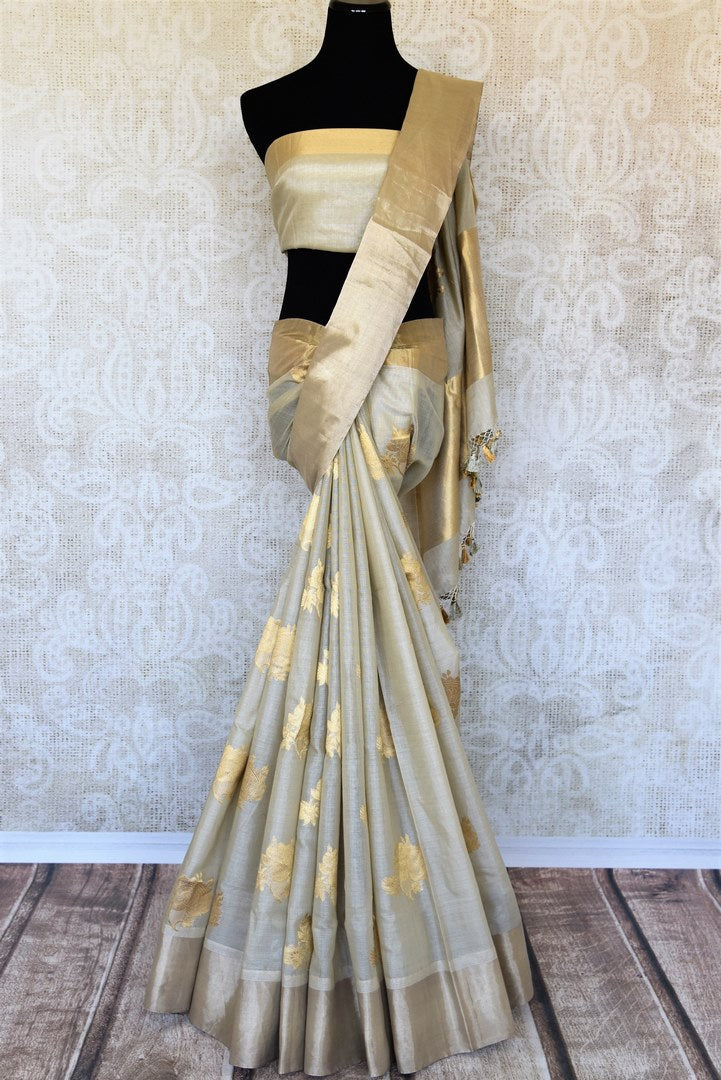 Adorn the beautiful grey linen banarsi silk sari featuring intricate buta work to elevate the grace of this saree. Immerse in royalty as you style this piece with a statement-worthy grey and gold zari blouse. Shop handcrafted silk sarees, silk saris online or visit Pure Elegance store, USA.-full view