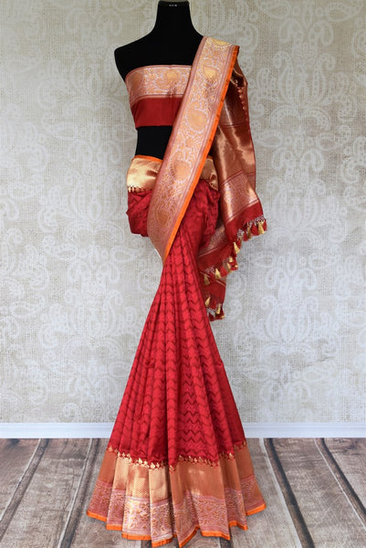 Drape in this luxe red with gold heavy banarsi silk saree. Your traditional treasure trove for all the important events, family meetings and weddings. Pair this saree with a gorgeous red and gold zari detailed blouse. Shop silk saris, ikkat sarees, printed sarees online or visit Pure Elegance store, USA. -full view