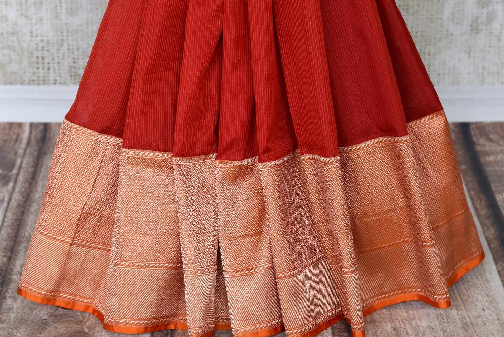 Drool-worthy designs scooped with stunning aesthetics in this graceful red banarsi silk saree. Beautifully laced with gold zari on the rich pallu and border, complemented with a designer red and gold blouse. Shop handloom sarees, designer silk saris, embroidered sarees online or visit Pure Elegance store, USA. -pleats