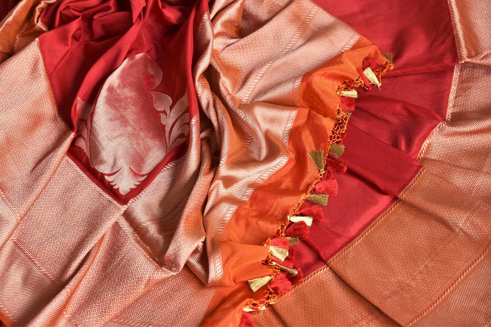 Drool-worthy designs scooped with stunning aesthetics in this graceful red banarsi silk saree. Beautifully laced with gold zari on the rich pallu and border, complemented with a designer red and gold blouse. Shop handloom sarees, designer silk saris, embroidered sarees online or visit Pure Elegance store, USA. -details