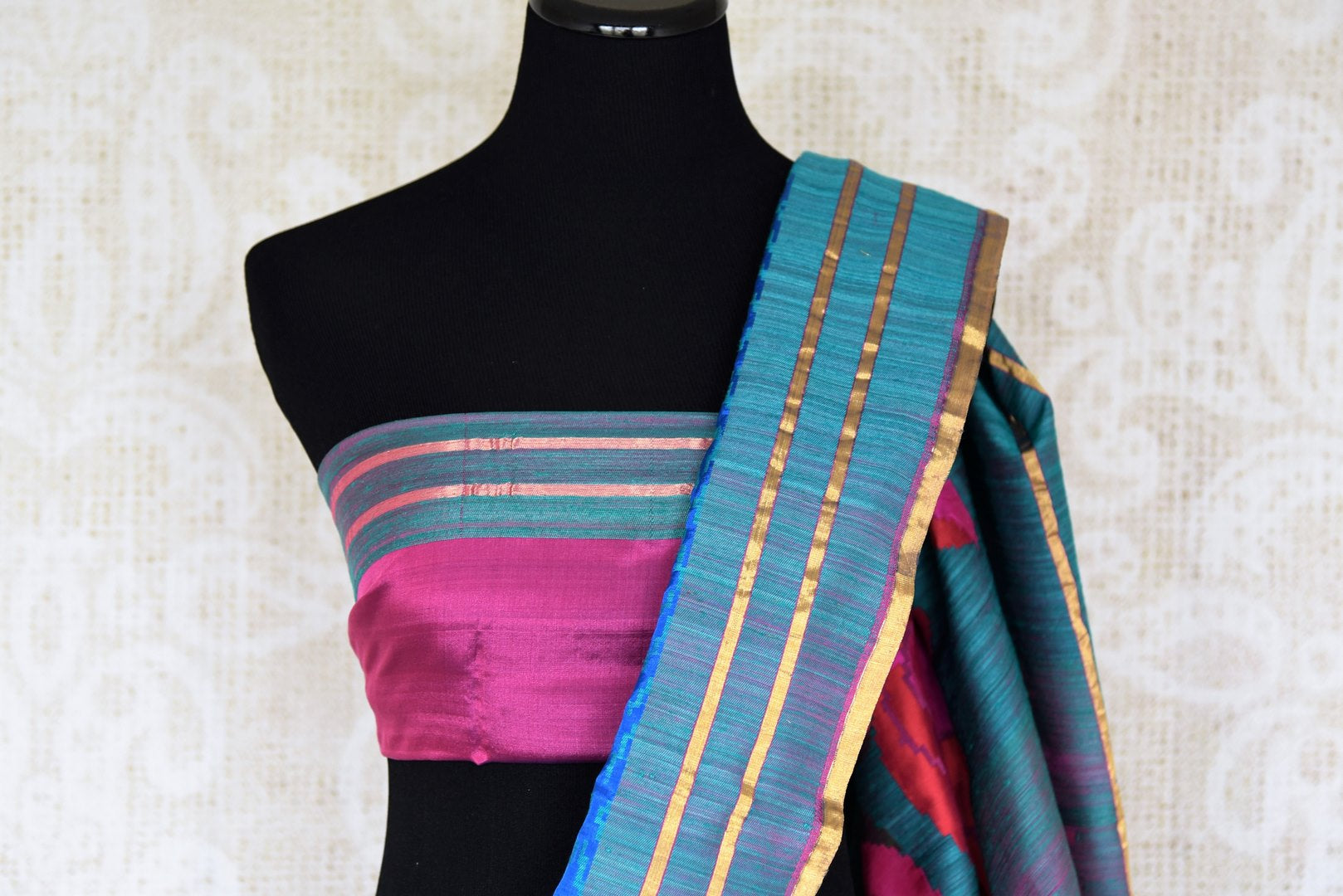 Luxe and lavish, this green banarsi silk saree with stunning zari detail looks flamboyant. Style this sari with a pretty pink silk blouse and enhance your look with heavily woven pallu and blue threadwork all over the saree. Shop handloom sarees, linen saris, ikkat sarees online or visit Pure Elegance store, USA.-blouse pallu