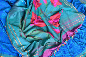 Luxe and lavish, this green banarsi silk saree with stunning zari detail looks flamboyant. Style this sari with a pretty pink silk blouse and enhance your look with heavily woven pallu and blue threadwork all over the saree. Shop handloom sarees, linen saris, ikkat sarees online or visit Pure Elegance store, USA.-pleats